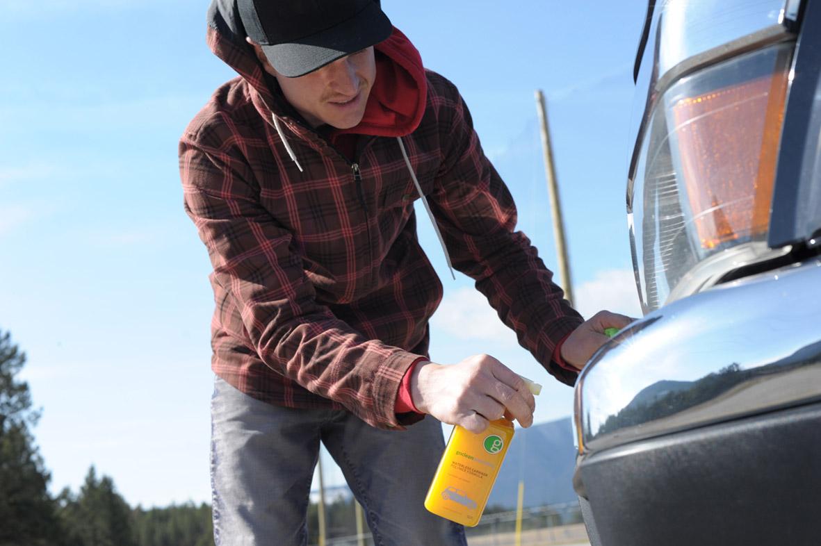 Aaron spraying a car